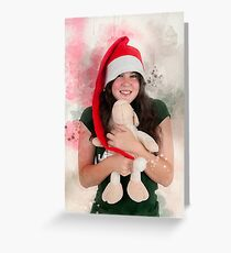 Digitally enhanced image of a Young teen wearing Santa's helper hat and hugging a stuffed Teddy bear with Christmas atmosphere  Greeting Card