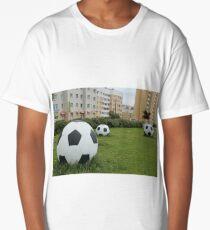 soccer balls on the green lawn Long T-Shirt