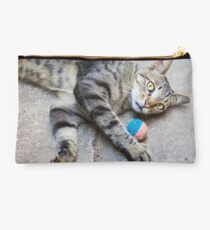 Cat plays with a ball Studio Pouch
