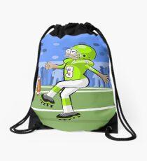 American football player kicking the ball Drawstring Bag