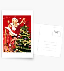 Pin up blond sexy girl is decorating Christmas tree Postcards