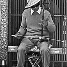 Chinatown Musician with His Erhu Instrument by Buckwhite