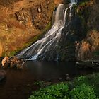 waterfall in the morning sun by codaimages