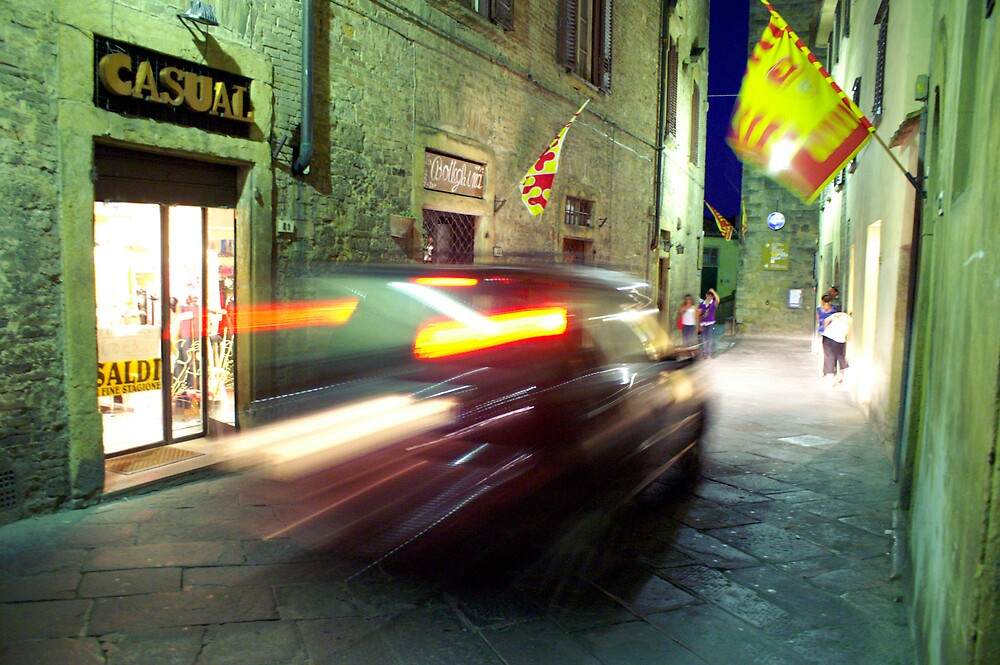 car rushing through the small streets, Italy by kimberleyB