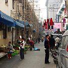Busy market street by Patrick Czaplewski