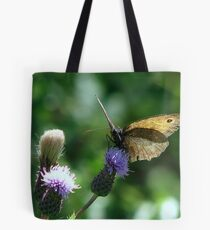 Alight a while Tote Bag