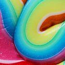 Closeup of a rainbow swirly lollipop by Karin Elizabeth