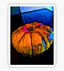 Still Life of an Orange Pumpkin with some Blue and Pink Sticker
