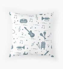 Vector pattern of sheet music and different musical toys: guitar, drum, trumpet, xylophone, maracas and other. Throw Pillow
