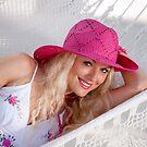 Cute girl resting in a hammock by Alexandr Zadiraka