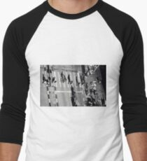 Elevated view of a city crossroads with zebra crossing and pedestrians crossing a street.with large shadows cast by the people.  T-Shirt