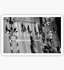 Elevated view of a city crossroads with zebra crossing and pedestrians crossing a street.with large shadows cast by the people.  Sticker