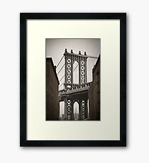 Empire State Building through arch of Manhattan Bridge Framed Print