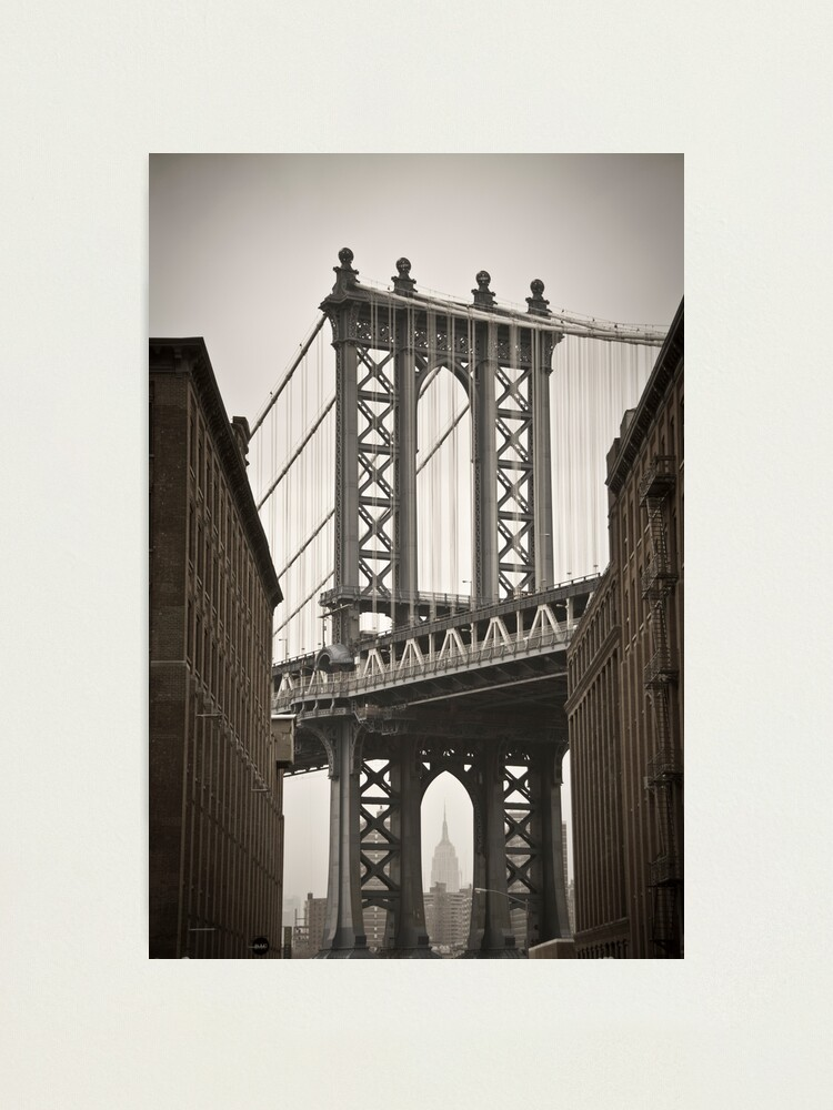 Alternate view of Empire State Building through arch of Manhattan Bridge Photographic Print