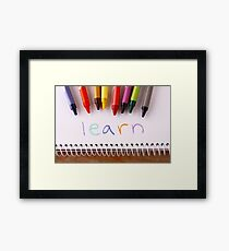 """Colorful crayons and the word """"learn"""" Framed Print"""