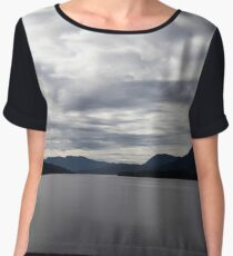 The sky in the clouds over the mountains and the fjord in Norway Women's Chiffon Top