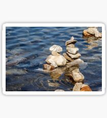 Norway trolls reflected in water - pyramids, laid out of stones Sticker