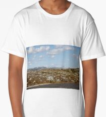 Road through the stone tundra with landmarks against a background of snow-capped mountains and a cloudy sky Long T-Shirt
