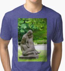 Stone statue of a loving couple at the National Opera Gardens, Riga, Latvia  Tri-blend T-Shirt