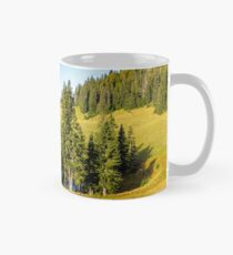 pine trees near lake on the meadow Classic Mug
