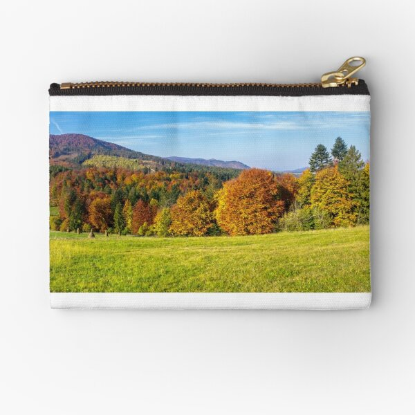 trees on autumn meadow in mountains Zipper Pouch