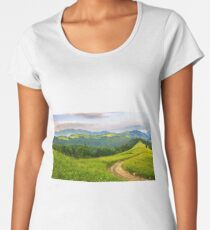 road through conifer forest in mountains at sunrise Women's Premium T-Shirt