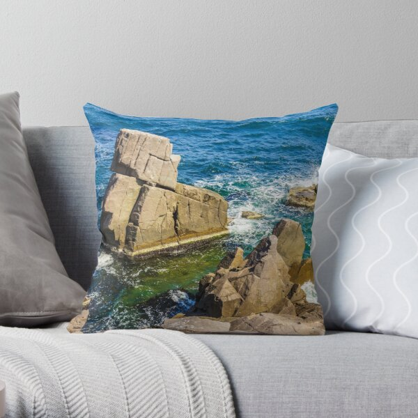 sea wave breaks about rocky shore Throw Pillow