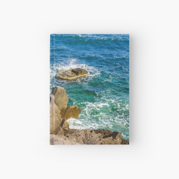 sea wave breaks about rocky shore Hardcover Journal