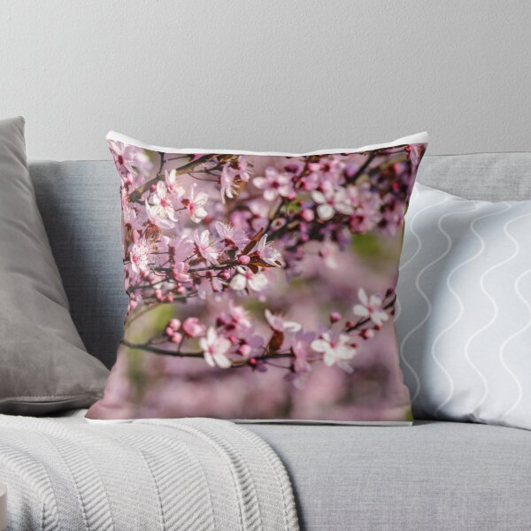 flowers of apple tree on a blur background Throw Pillow