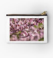 flowers of apple tree on a blur background Studio Pouch