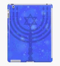Silhouette of Menorah Isolated on Blue Sky Background. Snow Flake Pattern. Symbol of Hanukkah iPad Case/Skin