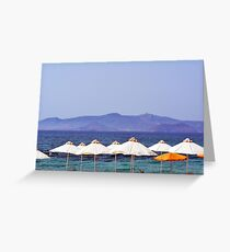 White umbrellas at the beach in Greece  Greeting Card