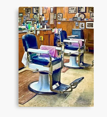 Two Barber Chairs With Pink Striped Barber Capes Canvas Print