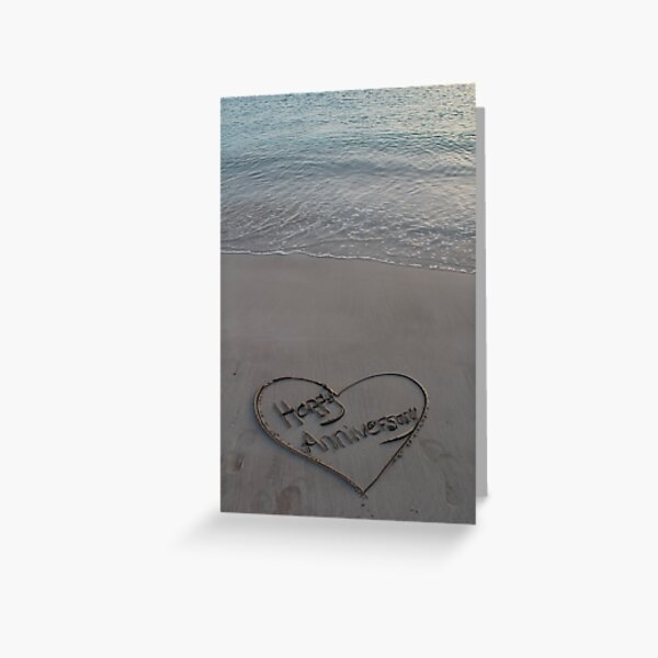Happy Anniversary written in sand Greeting Card