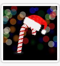 Candy Cane and Hat of Santa Claus 0n Dark Blurred Background Sticker