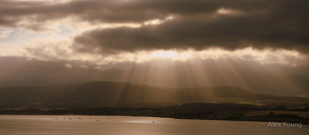 The sun is drawing over Ben Wyvis by Alex Young