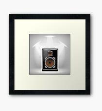 Musical Black Speaker on Light Gray Background Framed Print