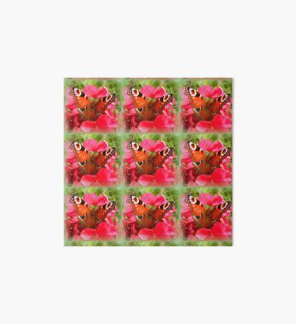 Peacock butterfly on geranium Art Board