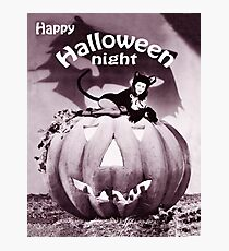 Pin up woman on black cat Halloween costume on a big pumpkin Photographic Print