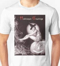 Pin up young witch sitting on a big pumpkin, Halloween greetings T-Shirt