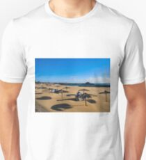 EMPTY BEACH AND STACKED SUNBEDS. T-Shirt