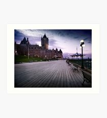 Fairmont Le Chateau Frontenac grand hotel Dufferin terrace in Quebec city with dramatic skies at night art print Art Print