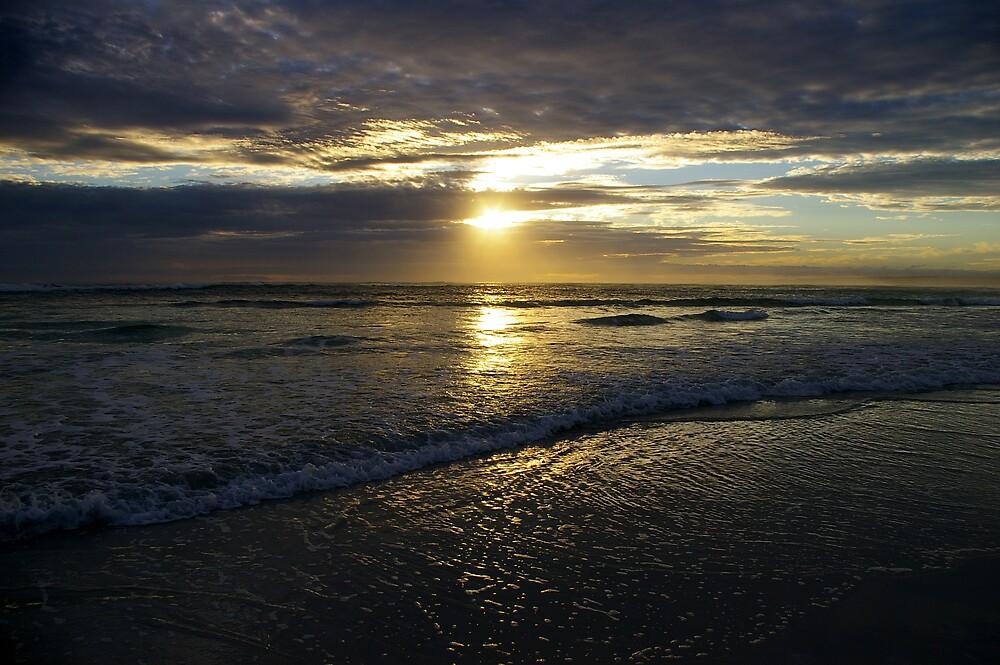 Just waves on a beach by Wayne England