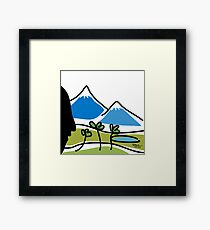A face in front of two mountains, trees and a lake Framed Print