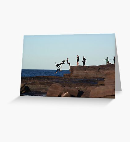 Youths dive off a rock platform on windang island Greeting Card