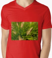 Bright spring grass field with sunlight bokeh background T-Shirt