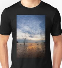 Lonely tree at muddy beach at sunset T-Shirt