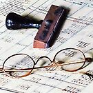 Ledger With Eyeglasses and Rubber Stamp by Susan Savad