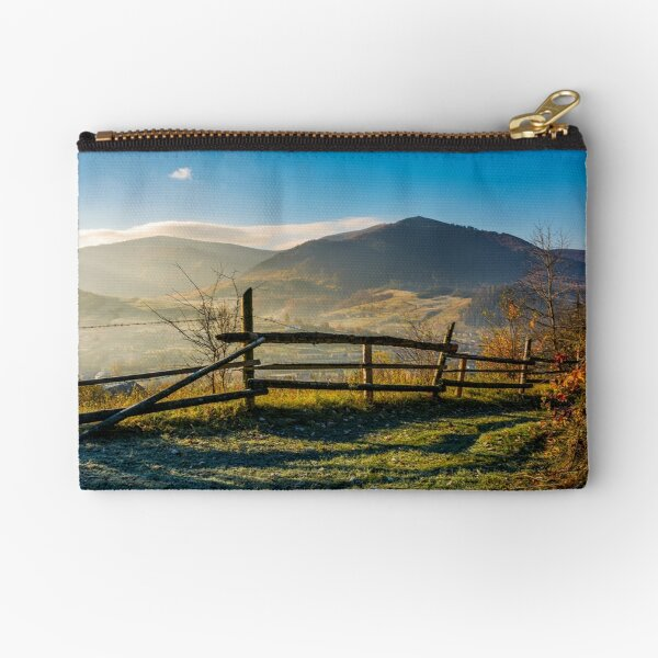 wooden fence near forest in mountains Zipper Pouch
