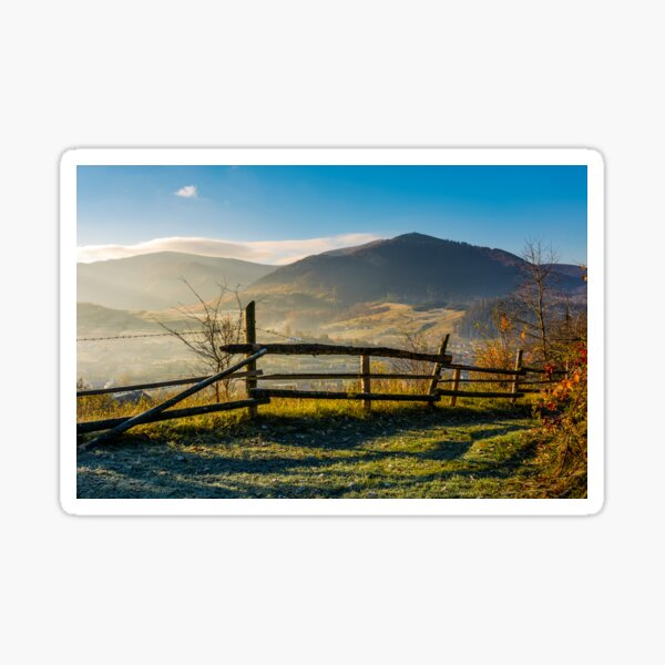 wooden fence near forest in mountains Sticker